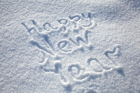 Photo pour Inscription Happy New Year on snowy winter background, text on snow surface - image libre de droit