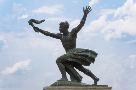 Statue of a torch bearer representing progress