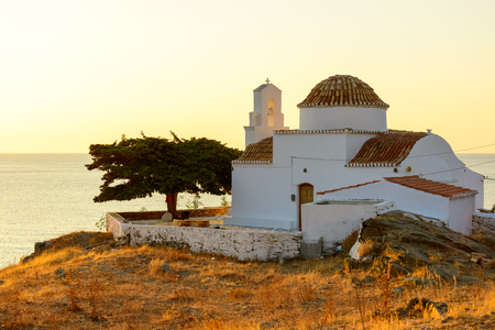 Small church of Panagia Flampouriani (Virgin Mary of Flampouriani) with a tiled cupola at Flampouria in Kythnos, Greece