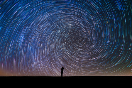 Photo for Silhouette of a person pointing to polaris - Royalty Free Image
