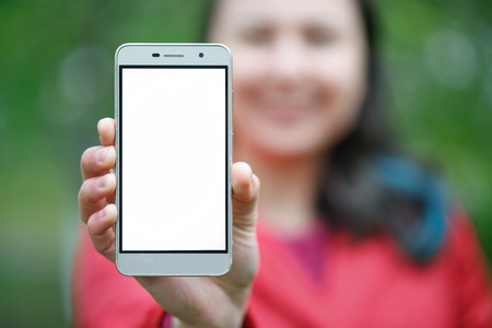 Photo for Close up of a female showing a blank vertical phone screen on the street Daylight - Royalty Free Image