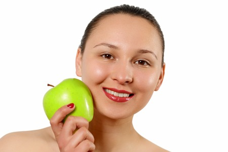 Photo pour Young beautiful smiling woman touches the apple to face - isolated on white. - image libre de droit
