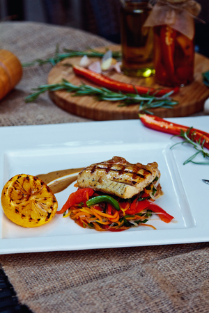 Baked perch fillet with rosemary and lemon with blanched vegetables