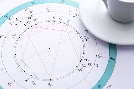 Photo for The desktop of an astrologer. The magical mysterious atmosphere of the working environment of the predictor of the future. Printouts of astrological charts and tables scattered across the table. - Royalty Free Image