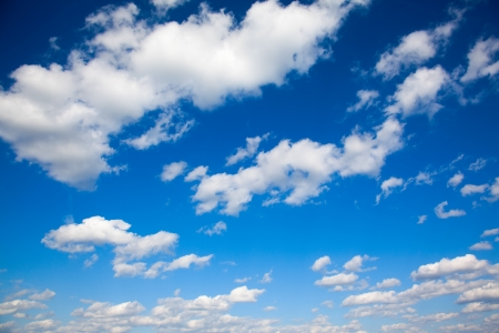 a bright blue sky with light clouds