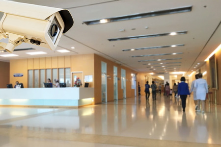 Photo pour The CCTV Security Camera operating in hospital blur background. - image libre de droit
