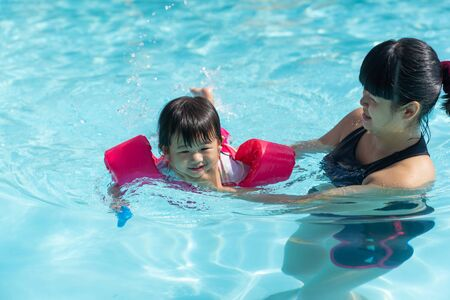 Foto für Asian cute little baby girl swimming underwater from mother take care in a pool, child learning to swim lessons and early development concept - Lizenzfreies Bild