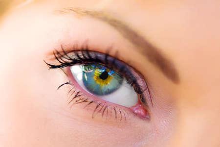 Photo pour The macro beautiful female eye  - image libre de droit