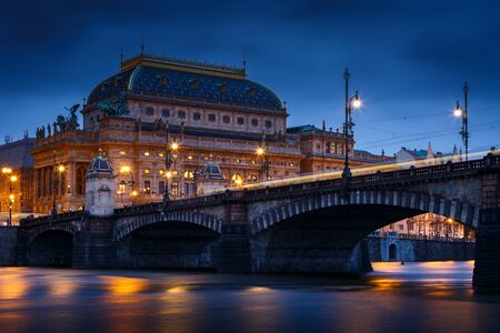 Photo for Evening view of the Legions Bridge and National Theatre in Prague from Strelecky island. - Royalty Free Image