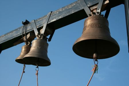 Three bells in the blue sky.
