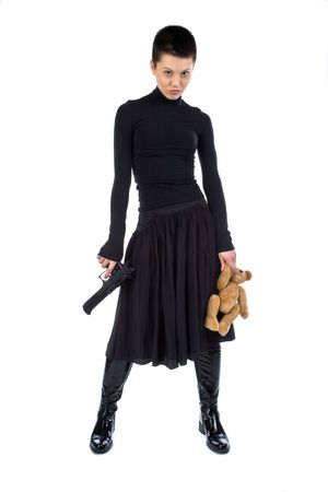 The aggressive girl in black with a pistol and teddy bear