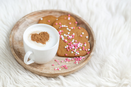Photo for Cappuccino with heart pattern of cinnamon, colorful confetti, valentines day cookies - Royalty Free Image