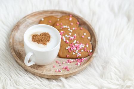 Foto de Cappuccino with heart pattern of cinnamon, colorful confetti, valentines day cookies - Imagen libre de derechos