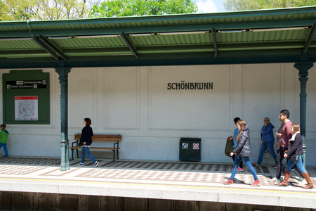 VIENNA, AUSTRIA - APR 30th, 2017: Passengers walking and waiting for a train at the subway or tram station Schonbrunn Palace