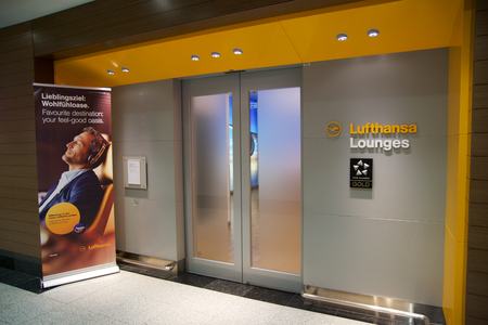 DUBAI, UNITED ARAB EMIRATES - NOV 14th, 2017: airport interior, airport Lufthansa senator lounge entrance with business man checking in