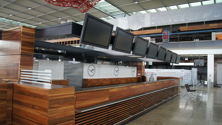 BERLIN, GERMANY - JAN 17th, 2015: Inside of the Berlin Brandenburg Airport BER, still under construction, check-in counter at the empty terminal building, architecture tour
