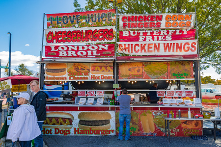 HICKORY, NC, USA-10/14/18: A concession stand at a local fall festival offers cheeseburgers and chicken wings.
