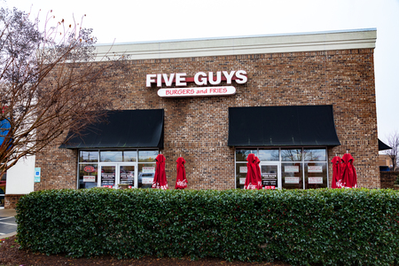 HICKORY, NC, USA-1/3/19: Five Guys is an American fast food restaurant chain, headquartered in Lorton, VA.  With over 1500 locations, many franchised.