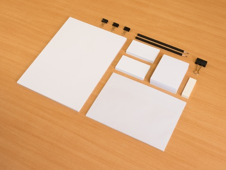 Blank stationery set on wood background a4 paper, business cards, envelopes.
