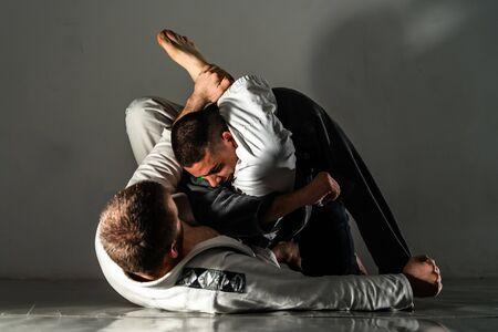 Foto de Brazilian Jiu Jitsu BJJ training sparring fight triangle submission - Imagen libre de derechos