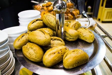 Many tasty fresh bread rolls in the cafe on counters