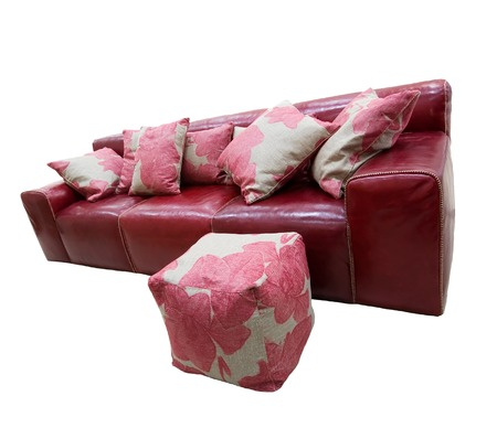 Red leather couch and puff isolated