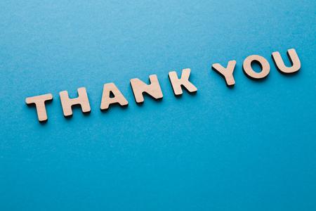Phrase Thank You on blue background. Politeness, thanks, gratitude concept
