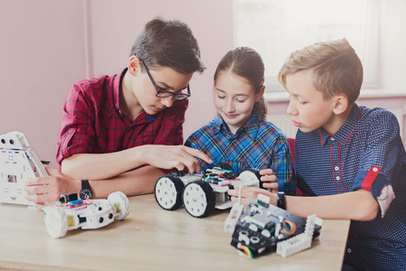 Photo for Children creating robots at school, stem education, copy space. Early development, diy, innovation, modern technology concept - Royalty Free Image