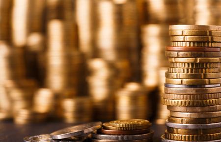 Photo pour Golden coin stacks, rich money background. Financial success, cryptocurrency mining, banking and profit concept - image libre de droit