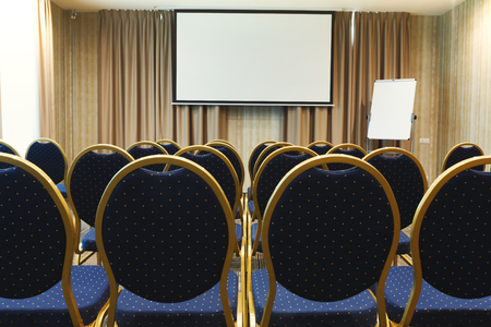 Interior of modern conference hall in contemporary hotel, perfect place for business meetings with luxury blue chairs, copy space