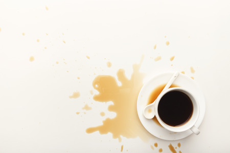 Foto de Cup of espresso and coffee spilt on white isolated background, top view. Mockup for grunge advertisement design, copy space - Imagen libre de derechos