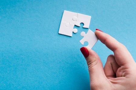 Photo pour Last connecting piece jigsaw puzzle. Business connection, success and strategy concept, copy space - image libre de droit