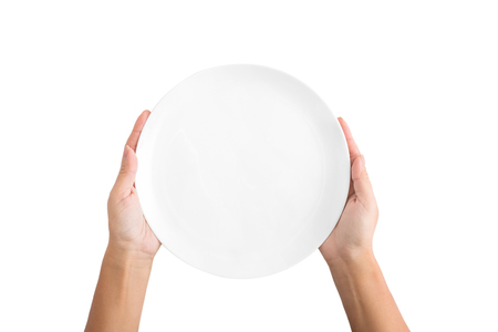 Photo pour Woman holding empty plate waiting for food, isolated on white background, top view, copy space - image libre de droit