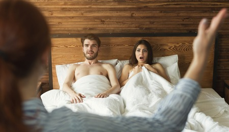Wife catching husband with mistress in bed, cheating in marriage, divorce reason