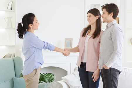 Photo for Expression of gratitude. Professional psychologist and happy thankful couple handshaking in office, free space - Royalty Free Image