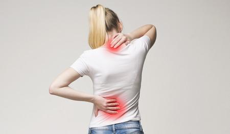 Photo pour Spine osteoporosis. Scoliosis. Spinal cord problems on woman's back. - image libre de droit