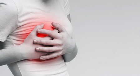 Photo pour Breast pain. Woman suffering from painful feelings, clutching her boob, monochrome photo with red spot, panorama - image libre de droit