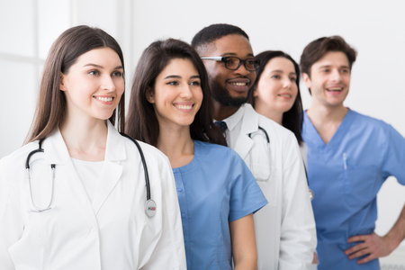 Photo pour Team Of Medical Interns. Successful Practitioners Standing In Hospital - image libre de droit