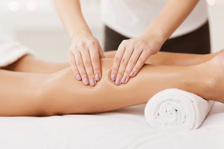 Photo pour Massage Therapist Massaging Woman Calves In Spa Center, Closeup - image libre de droit