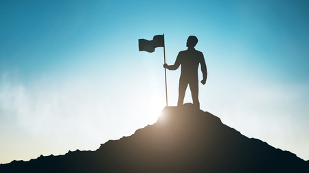 Photo pour Silhouette of man with flag on mountain top over sky and sun light background - image libre de droit