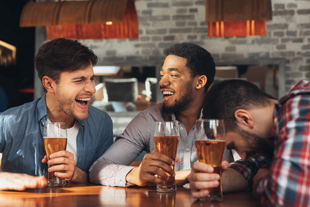 Photo for Friends Meeting. Men Drinking Beer And Talking, Having Rest In Bar Together - Royalty Free Image