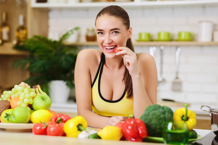 Photo for Healthy Lifestyle. Sporty Woman Standing Near Fruits And Vegetables In Kitchen - Royalty Free Image