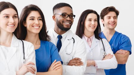 Photo for Happy Medical Staff Standing Together In Clinic, Posing With Crossed Arms - Royalty Free Image