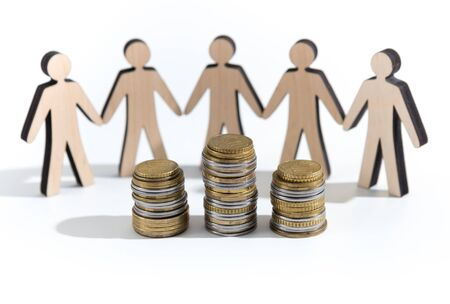 Photo for Wooden cut out human deciding to crowdfunding all their savings in coins, panorama, copy space - Royalty Free Image