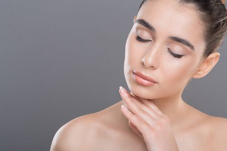 Photo pour Natural skincare. Young woman caressing her smooth soft skin with closed eyes, copy space - image libre de droit