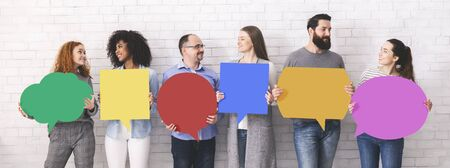 Photo pour Sharing ideas. Group of millennials holding blank colorful speech bubbles with empty space, panorama - image libre de droit