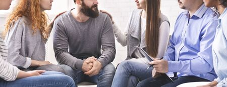 Photo for Rehab group meeting. Women comforting stressed man at support therapy, panorama - Royalty Free Image