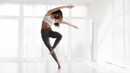 Photo for Pretty Girl Dancing Contemp and Ballet In Modern Dance Studio. Panorama, Empty Space for text - Royalty Free Image