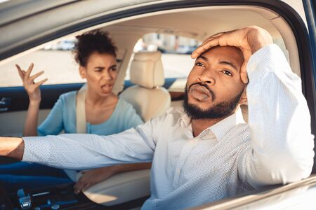 Photo pour Missed road. Afro couple arguing during their journey in car, frustrated man looking aside - image libre de droit