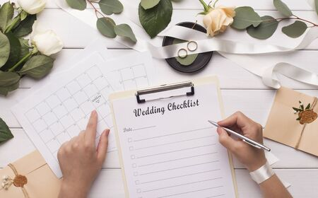 Photo for Woman writing wedding items in checklist for planning budget, panorama - Royalty Free Image